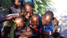 Our onsite Director, Leens, with children of the village.