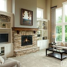 Soaring ceiling and stone fireplace. Notice the windows above built- ins.