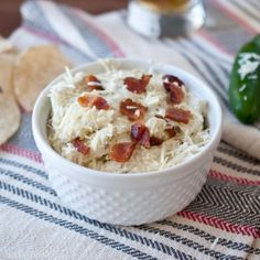 Jalapeno Bacon Dip (2 fresh jalapenos 16 ounces cream cheese 6 strips of bacon, cooked and chopped 1 cup parmesan cheese, plus 1/4 cup divided 1/2 cup sour cream 1/2 tsp garlic powder 1/2 tsp smoked paprika)