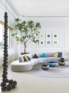 In the sitting room of a Beirut home by Claude Missir Interiors, a custom sofa and vintage Gio Ponti chair meet a trio of Piergil Fourquié tables in blown glass and scree. Sofa Furniture, Luxury Furniture, Furniture Design, Furniture Makers, Furniture Storage, Wooden Furniture, Living Room Sofa, Living Room Interior, Living Room Ideas