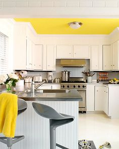 Lemon yellow ceiling in a crisp kitchen - Decoist