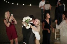 Catch the bouquet, one happy lady!