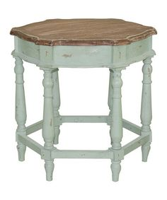 I really love everything about this uniquely shaped accent table!