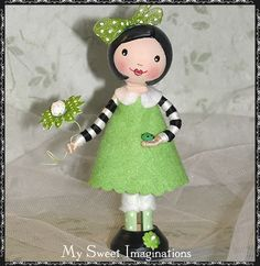 Woolfelt Clothespin Dolls - My Sweet Imaginations.  No tutorial but these clothes pin dolls are beautiful.