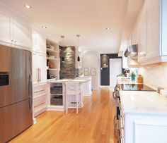 Classic / contemporary kitchen style with white lacquer cabinets.