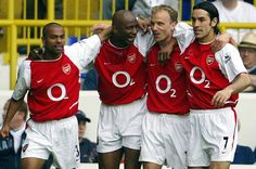 Good old days: Arsenal's captain Patrick Vieira celebrates his goal against Tottenham with teammates Ashley Cole, Dennis Bergkamp and Robert Pires at White Hart Lane, April 2004
