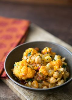 Cauliflower Chickpea Curry ~ Delicious vegan curry with cauliflower, chickpeas, onion, tomato, and cilantro. ~ SimplyRecipes.com