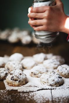 Snowballs -tastiest cookies 3/4 c butter, room temp 1 tsp vanilla 1 TBS water 1/8tsp salt 1/3 c sugar 1 1/2 c flour (this time I added a pinch of cinnamon, just for kicks) 1 c chocolate chips 1 c chopped pecans or walnuts (I like pecans) Powdered sugar, for dusting