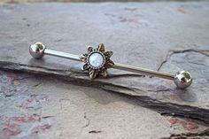 Antiqued gold tribal sun opal industrial barbell piercing or scaffold piercing for your upper ear. The barbell is 14 gauge and 1.5 inches long or 38mm, with both ends unscrewing from the barbell. The