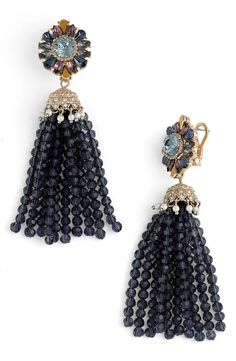 Luxe and regal, these sparkling tassel earrings are strung with faceted crystals and topped with shimmering studs that mimic blossoming floral buds.