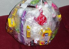 Tape Ball group game. Tape up all kinds of candy or small prizes. Roll a dice, once you get a 1 or 6 on the dice you get to grab the tape ball from the person next to you. try to get all the tape off. if you untaped a piece of candy, its yours. play that way until the whole tape ball is done... great game for parties.