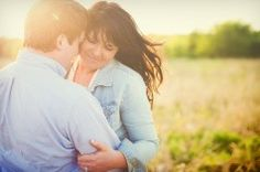 a couple's embrace in sweet sunlight in a country field