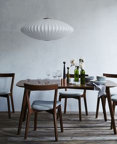 Dwell dining room featuring Juniper table and chairs, HAY glassware, a Nelson Bubble Lamp and more