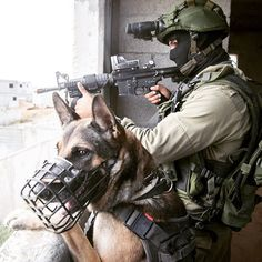 """""""Who let the #dogs out? Oketz Special Forces soldier trains with his four-legged auxiliary for urban #warfare."""""""