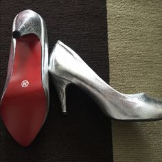 New in the box! NEVER WORN! Stunning sparkling silver 3 inch heels with RED bottoms! Bought on line and to big for me. Fits a 7 or 7 1/2 size shoe. No name brand that I recognize. Louis Vuitton Shoes Heels