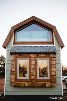 The Molly: a beautiful, luxury tiny house with two bedrooms, a full kitchen, and a window seat!