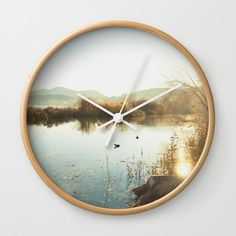 """Autumn Lake Tranquility Wall Clock by ARTbyJWP via Society6 #homeoffice #wallclock #walldeco #clock #decoration #shop #shopping #artbyjwp -  Available in natural wood, black or white frames, our 10"""" diameter unique Wall Clocks feature a high-impact plexiglass crystal face and a backside hook for easy hanging. Choose black or white hands to match your wall clock frame and art design choice. Clock sits 1.75"""" deep and requires 1 AA battery (not included)."""