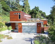 Blu Homes Sidebreeze in Orinda - green roof, aluminum garage door with frosted glass panels.