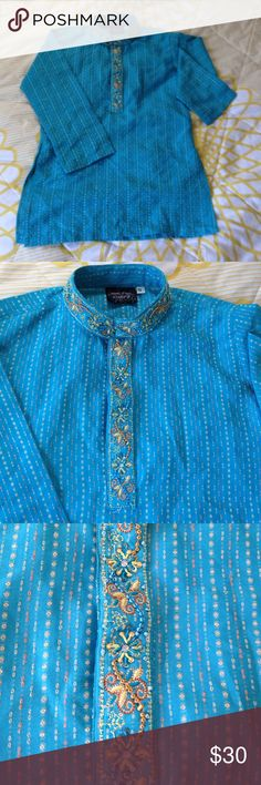 Boys kurta bright blue! Bright blue kurta with embroidery around the neck line perfect for Eid shadi mehndi dewali Or other occasions like these. It would fit ages 3 to 5 . Tops