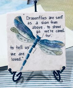 An Original dragonfly painting designed by Carole. I painted this dragonfly on a stone tile which makes a lovely coaster.  My dragonfly is a miniature oil painting on a marble tile. I apply three coats of polyurethane to each tile for protection.  The tile has a distressed look which