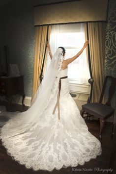 A gorgeous lace Pronovias wedding gown with a long train.   Real Wedding The Molly Pitcher Inn, Red Bank, NJ