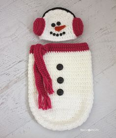 Free crochet pattern for a snowman ear muff hat and cocoon by Repeat Crafter Me.