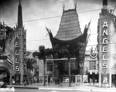 "Howard Hughes' ""Hell's Angels"" displayed on the columns outside Grauman's Chinese Theatre, 1930"