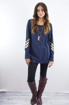 """This luxurious tunic is a comfortable classic. Pair this with tall boots and your favorite jeans!  Fits true to size model is size 4, 5'6"""" tall and she wears size small. SIZES(Fits true to size in relaxed)Small (0-4)Medium (6-8)Large (10-12)95% polyester 5% spandex"""