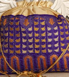 Cream Silk Potli Bag With Kantha Embroidery