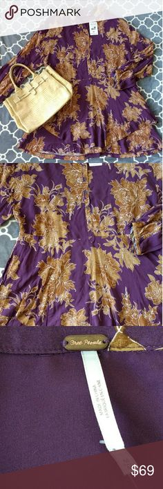 NWT Free People Shake it Berry Comb dress size M NWT Free People Shake it Mini dress  Size M Color Berry Comb (aubergine color with flowers print) Adjustable waist  Material 100% Rayon  Condition: New with tag, bought from Macy's Free People Dresses