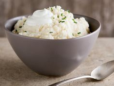 Garlic Mashed Potatoes with Chives and Greek Yogurt   Put a healthy spin on garlic mashed potatoes by adding Greek yogurt, which provides a lot of creaminess without tons of fat.