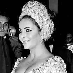 1966 She chose a dramatic beaded turban for an Italian awards show.