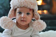"baby photo of Elle in Baby Gap pink ""Yooper"" hat."