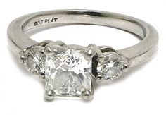 plain platinum band (3.5g) and platinum engagement ring (4.8g total) with 1 carats radiant cut diamond in the center and two 0.125 carats round brilliant on the side. The center diamond has VS-2 clarify, E color, with good finish and good proportions (5.75 x 5.06 x 3.70 mm). The two side dimaons are SI to SI-2 clarity and G-H color with good proportions and finish. The rings are currently sized 5. Attached is a picture of the appraisal of the diamond ring for insurance purposes. It appraise... Radiant Engagement Rings, Platinum Engagement Rings, Radiant Cut Diamond, Thing 1, Art Carved, 1 Carat, Diamond Wedding Bands, Clarity, Two By Two