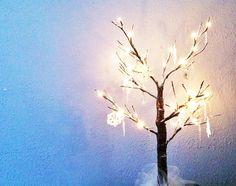 Light up table top tree with icicle ornaments and crochet snowflakes.