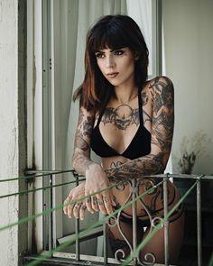 Tattooed girl Slava Satana