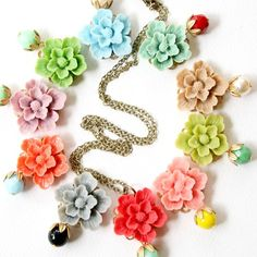 pretty cabochons in lovely colors! The little extra bead detail below each flower makes this necklace great.