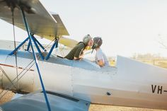 couple in airplane engagement photos 8-Grafton-Wedding-Photographer-