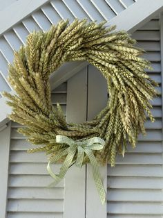 I love this. So natural and simple. I wonder what local plant I can use.-ajc☕️  Wheat Wreath  Natural Original Wheat Wreath  Summer by SteliosArt