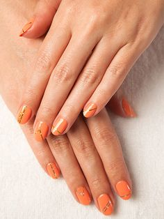 We love this coral manicure decorated with strips of gold foil—the handiwork of Regina Rodriguez at Vanity Projects Salon in New York City. She told us how we could re-create the design on our own...