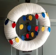 Yarn Wreath Felt Handmade Holiday Door - Light It UpChristmas 12in. $45.00, via Etsy.