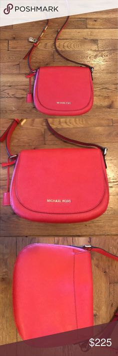 Michael Kors Crossbody purse This is a like new Michael Kors cross body purse. I only used it once. I'm more of a tote girl. The color is a reddish orange. It is very pretty. The inside is in perfect condition, as so is the outside. Michael Kors Bags Crossbody Bags