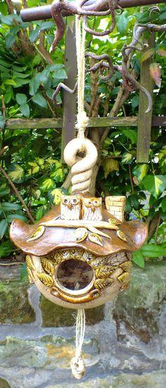 http://de.dawanda.com/product/63538171-vogelhaus-lbaumhaus-vogelvilla-futterhaus-unikat