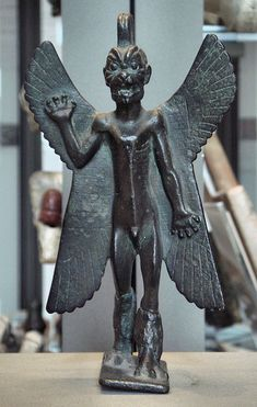 Pazuzu - Origin: Assyrian and Babylonian mythology Attributes: As king of the wind demons, he is known for inflicting humankind with storms, droughts, and plagues. Also notable for possessing Regan from The Exorcist (1973).  Appearance: He is depicted as having a scaly body, a dog-like head, taloned feet, wings, a scorpion's tail.