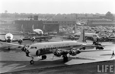 Atlanta Municipal Airport, 1956  A shiny new Eastern Air Lines Douglas DC-7 heads for the taxiway. The brick building in the background remained until the mid-1980s.