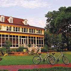 Deep in the heart of the Lowcountry, this inn is actually a collection of colonial-style cottages and suites set on 20,000 acres of preserved wilderness. The weeping willow trees, slow-moving May River and expansive porches will make you feel like you just walked onto the set of a Nicholas Sparks movie. Grab your partner and explore the trails on beach bikes, or take a tour through the surrounding forest, where you can spot wild boar, deer and armadillos. At night, after you've had your…
