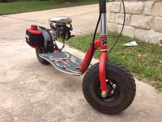 Rare red Super Bigfoot go-ped with all the extras you'd long for on a goped. This go ped is tops out at around 34mph.