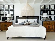 Love the black bed with distressed mismatched cabinets and the stark white bedding pops.