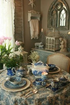 Blue & white repeated in tablecloth. Antique tea set, silver and vintage blue & white plates
