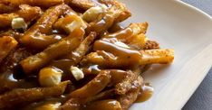 Try this poutine with guiness gravy recipe! Poutine - french fries & cheese curds, smothered in guiness gravy. If you love poutine you'll love this recipe! Poutine Gravy Recipe, Guinness Recipes, Gravy Fries, Grilling Recipes, Cooking Recipes, Canadian Food, Irish Recipes, Veggies, Dumplings
